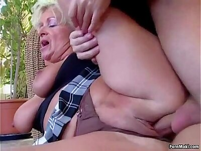 Chunky titted materfamilias takes young cock